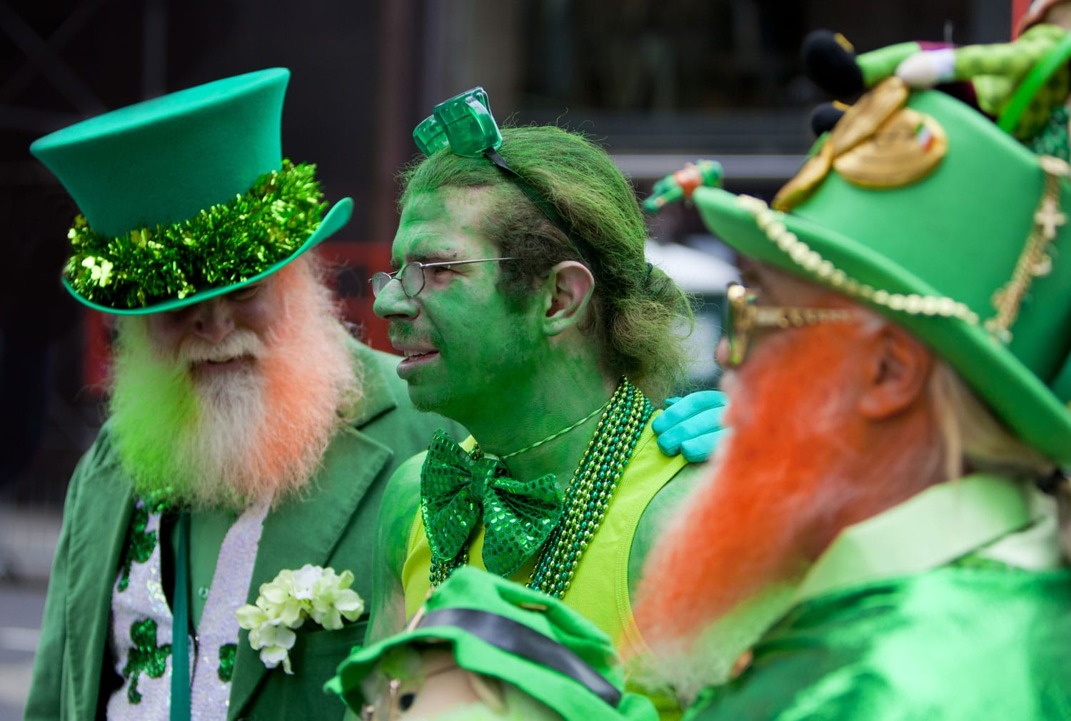 hree men in funny leprechaun costumes at the St. Patrick's Day Parade