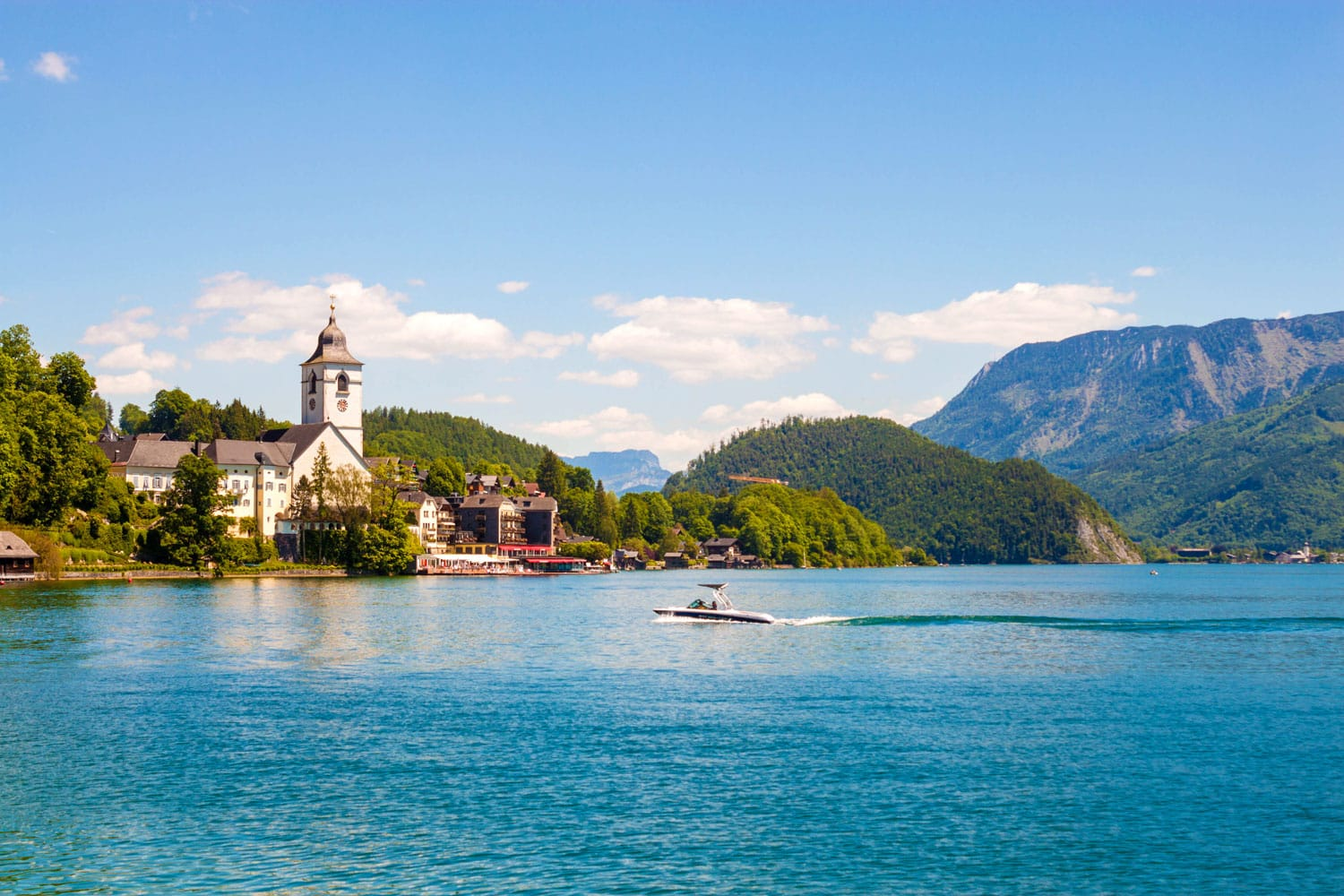 View of St. Wolfgang chapel and the village of St. Wolfgang at Wolfgangsee lake, Austria