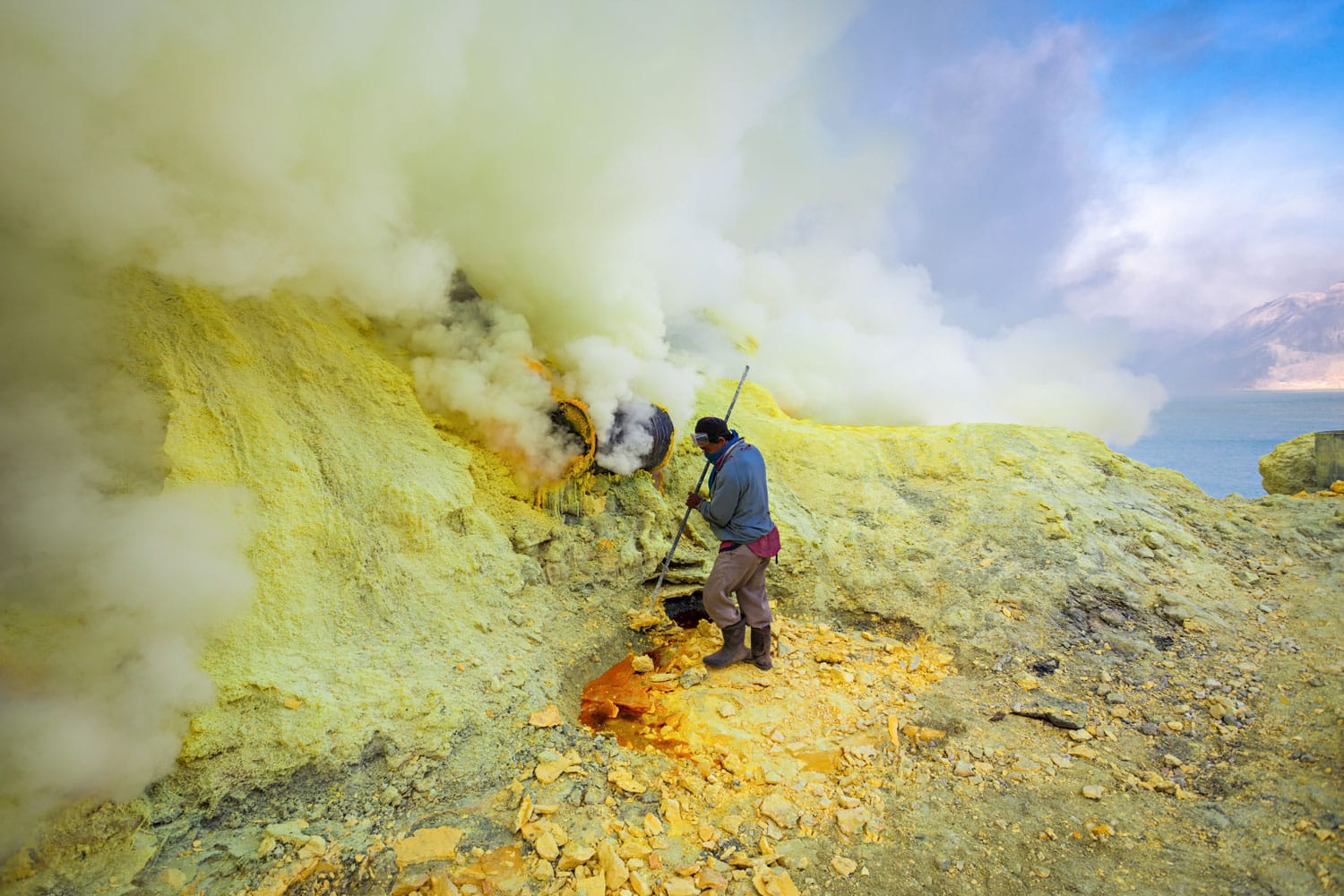 Sulfur miners inside crater Ijen volcano crater, Banyuwangi district, Indonesia
