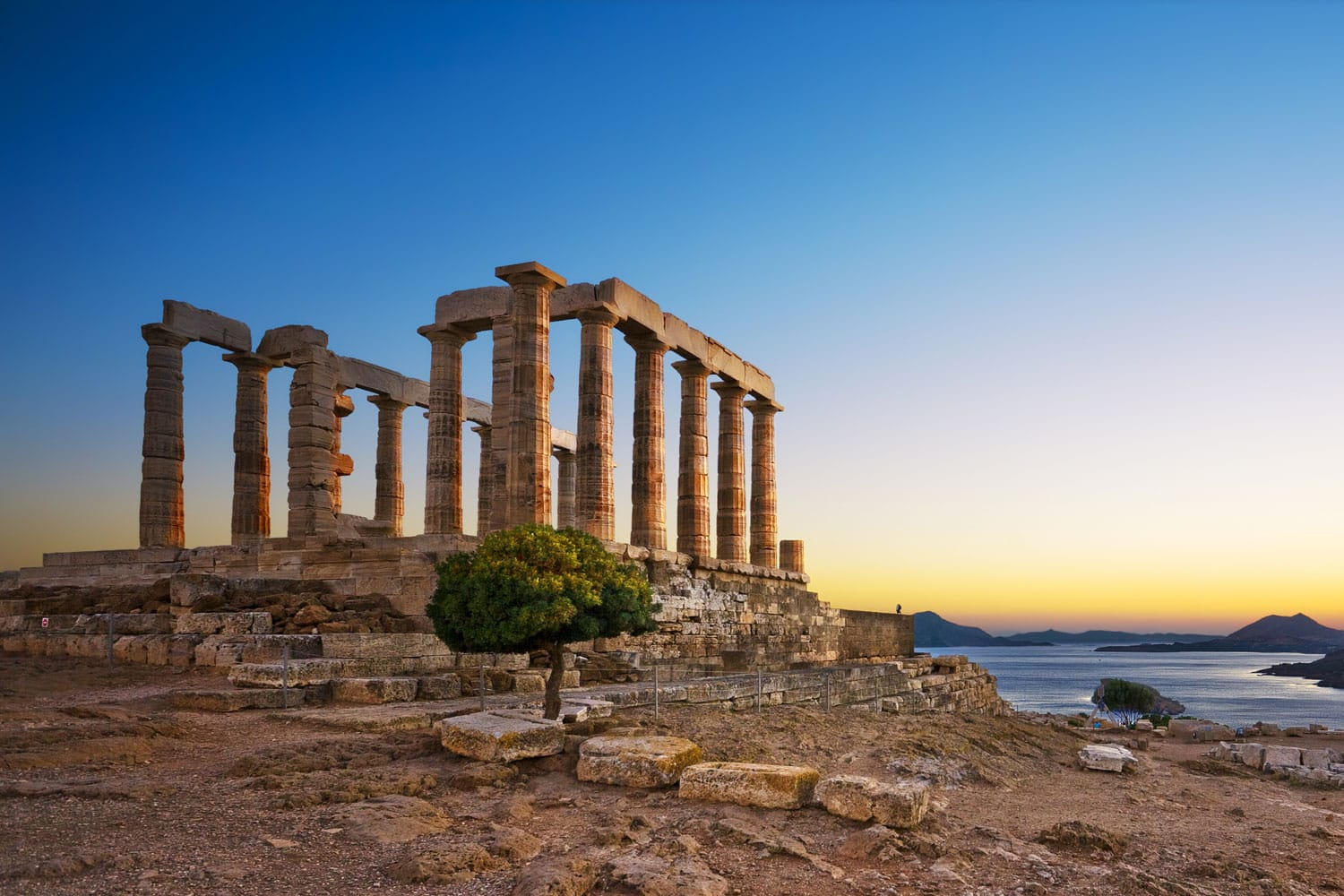 Ruins of an ancient Greek temple of Poseidon after sunset