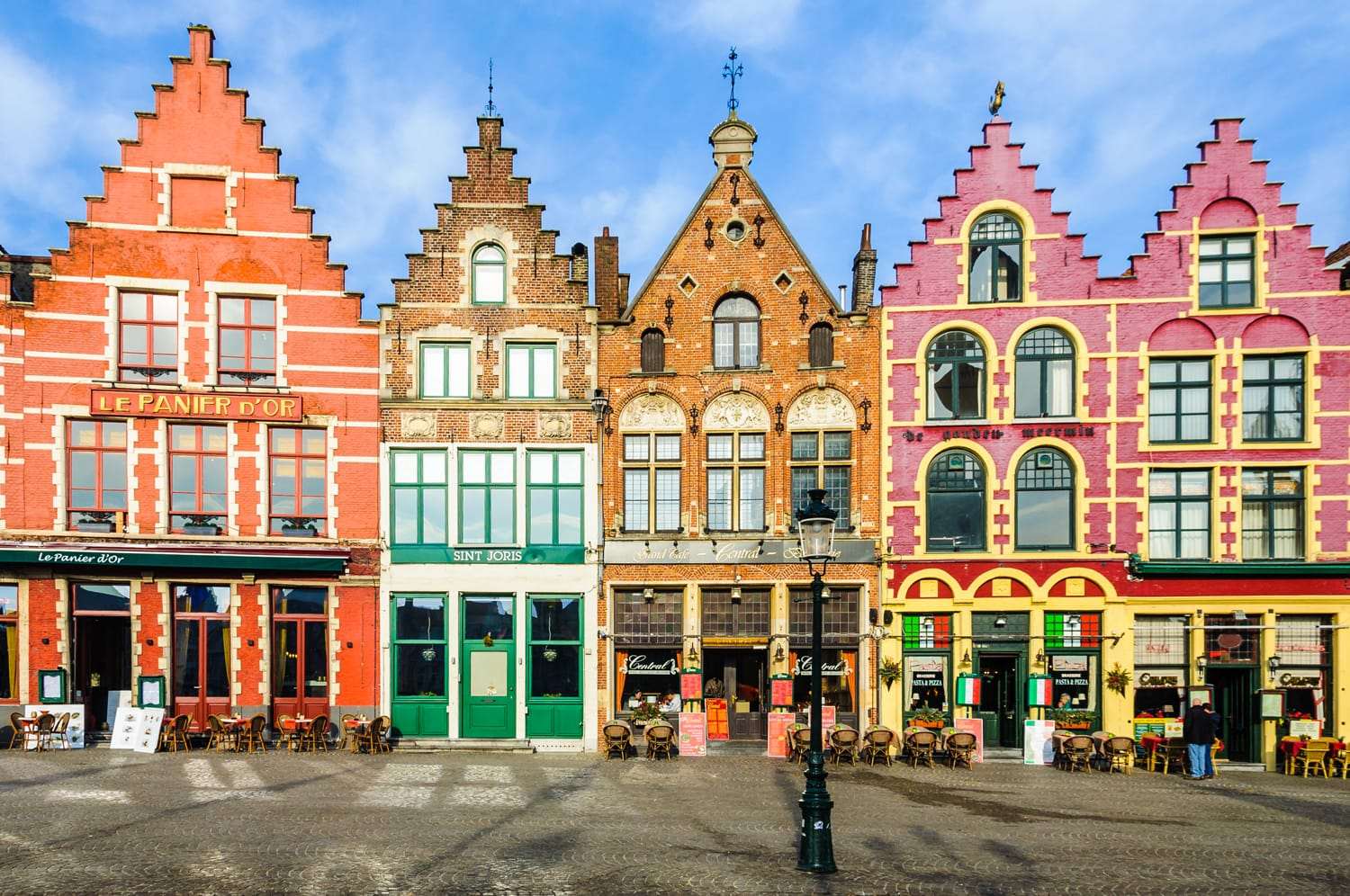 Colorful old brick houses in the Market Square in the UNESCO World Heritage Old Town of Bruges, Belgium