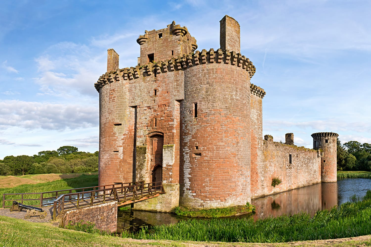 Caerlaverock Castle on a bright sunny day an idyllic scene in Dumfries and Galloway near the Scottish Border.