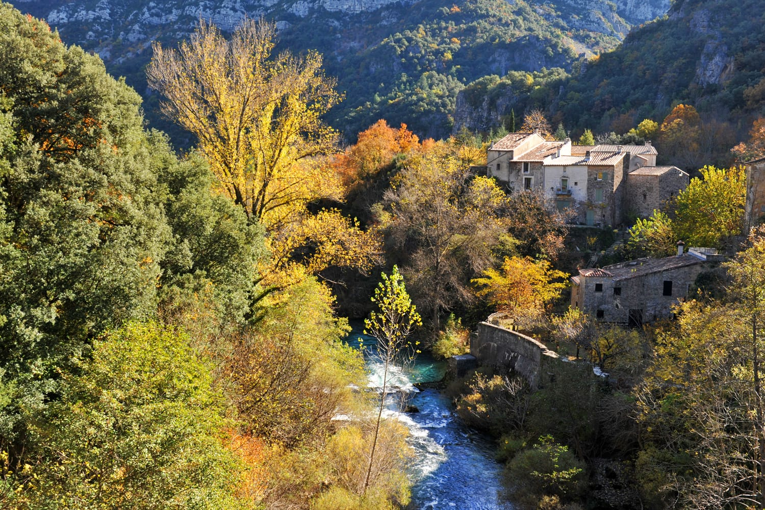 Typical village in Cevennes Mountains with river