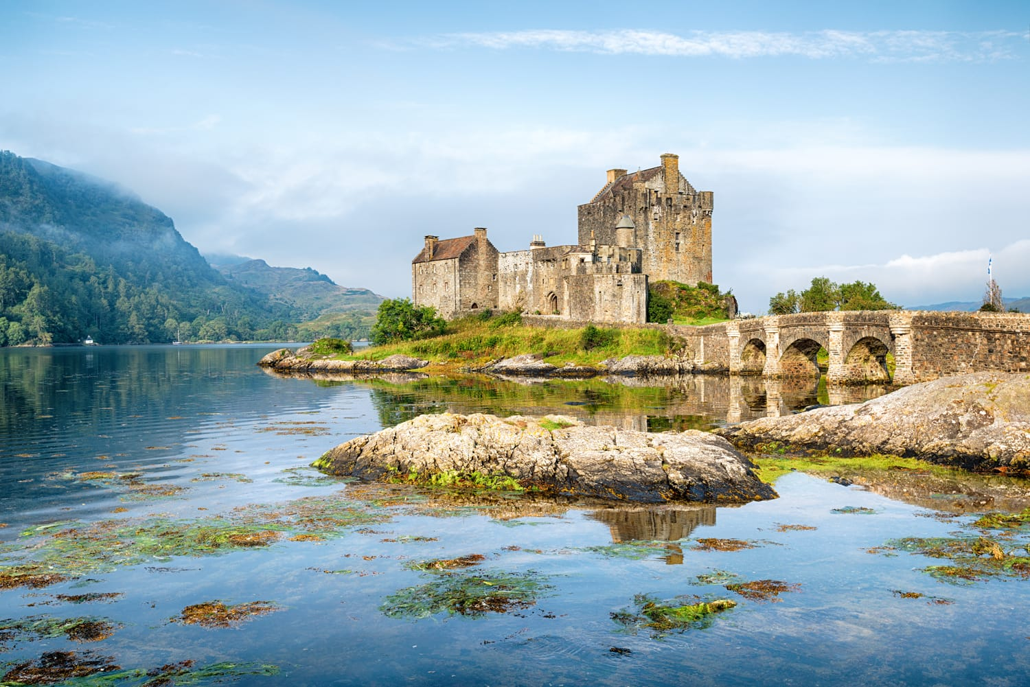 Early morning sunlight over Eilean Donan Castle at Kyle of Lochalsh in the Western Highlands of Scotland