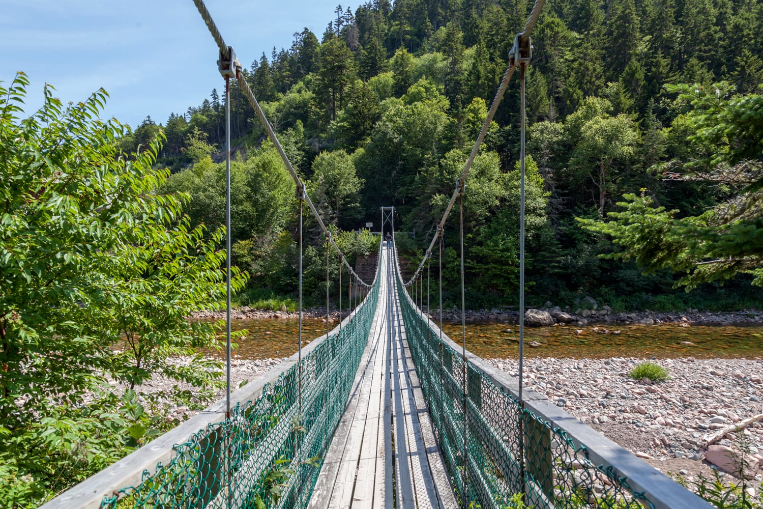 Suspension bridge crossing the Salmon River in the Fundy National Park New Brunswick Canada