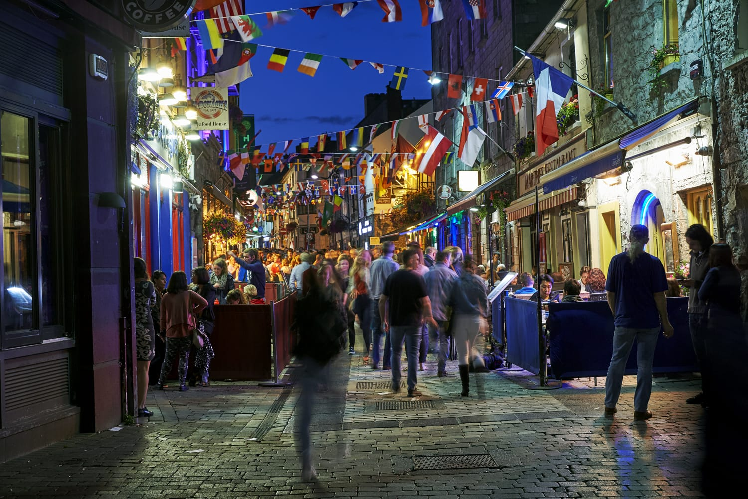 Vibrant cafe and bar culture in the city centre of Galway illuminated at night