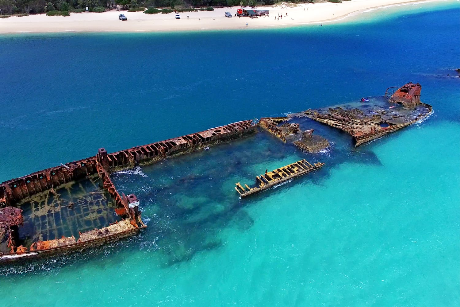 Aerial view of Tangalooma Island shipwrecks and national park in Moreton Bay region, Queensland Australia