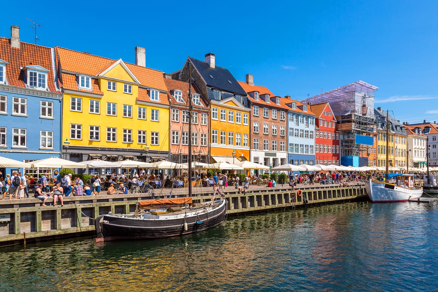 Nyhavn district is one of the most famous landmark in Copenhagen in a summer day