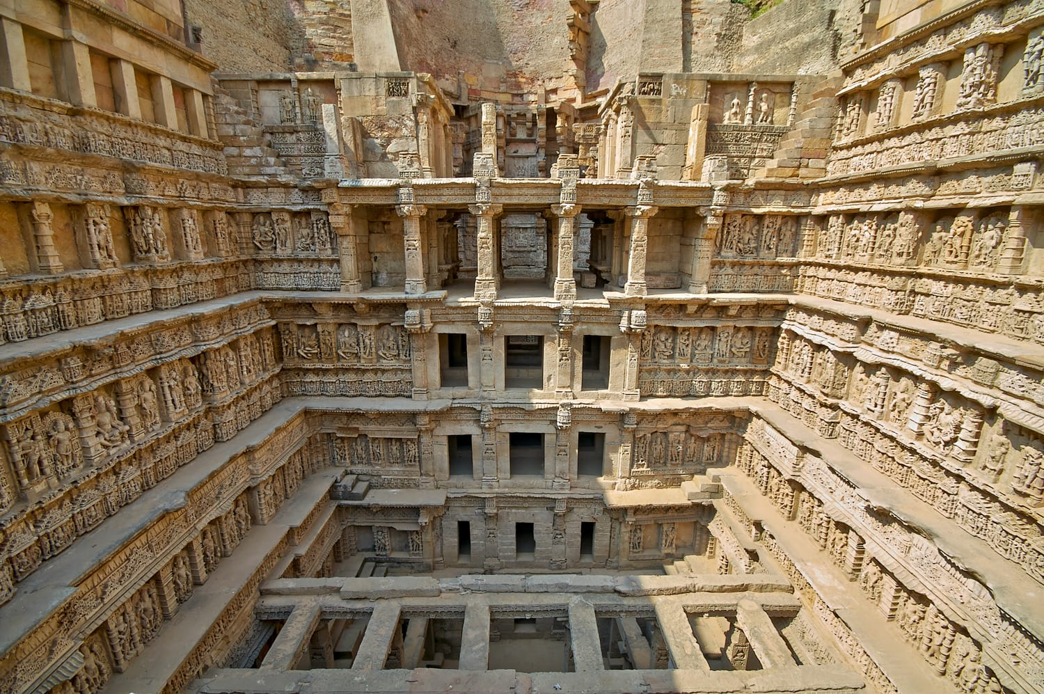 Ornate stone carved walls lining the 11th century Rav-Ki-Vav stepwell at Patan, Gujarat, India. Selected as a UNESCO world Heritage Site