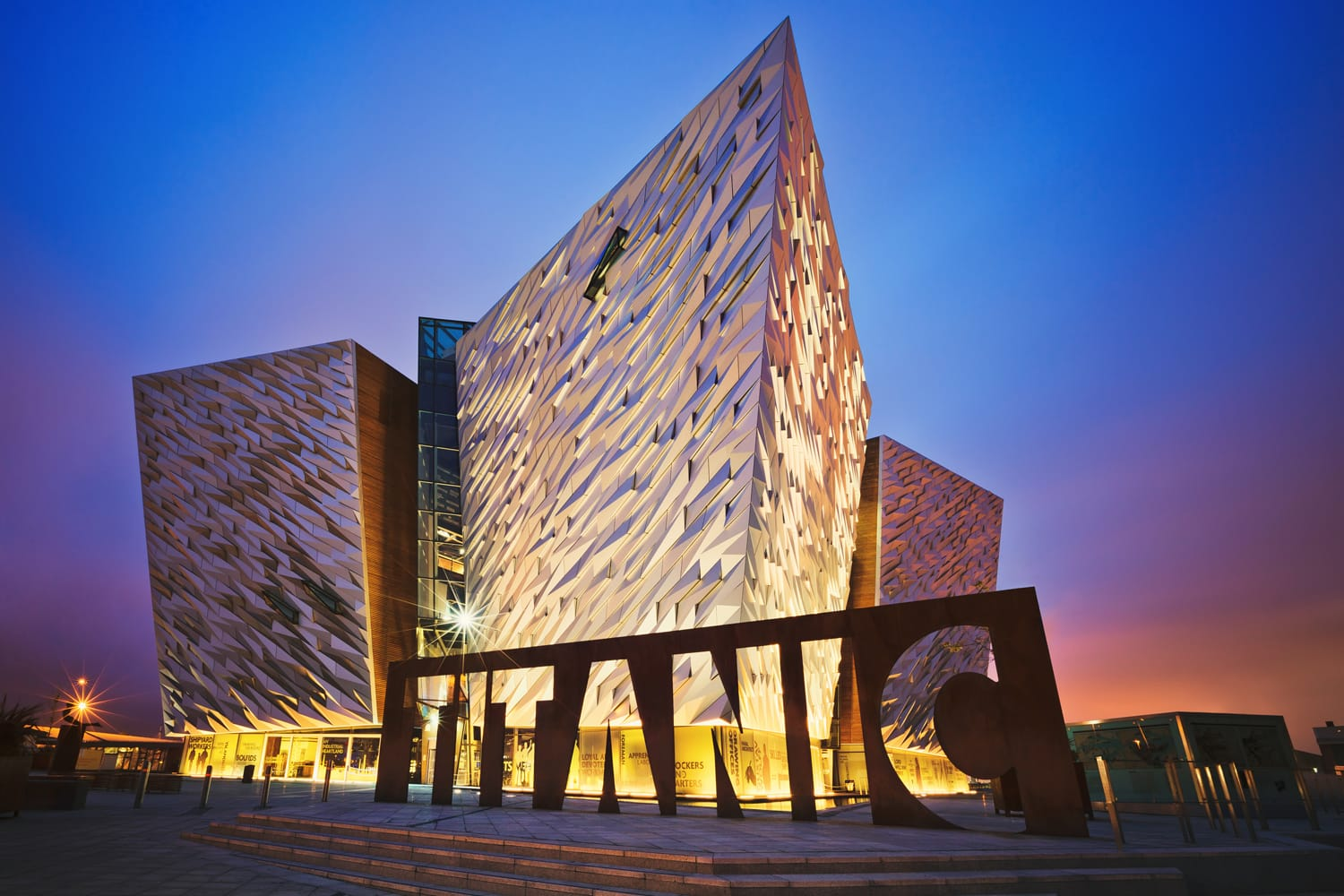 Sunset over Titanic Belfast - museum, touristic attraction and monument to Belfast's maritime heritage on the site of the former Harland and Wolff shipyard.