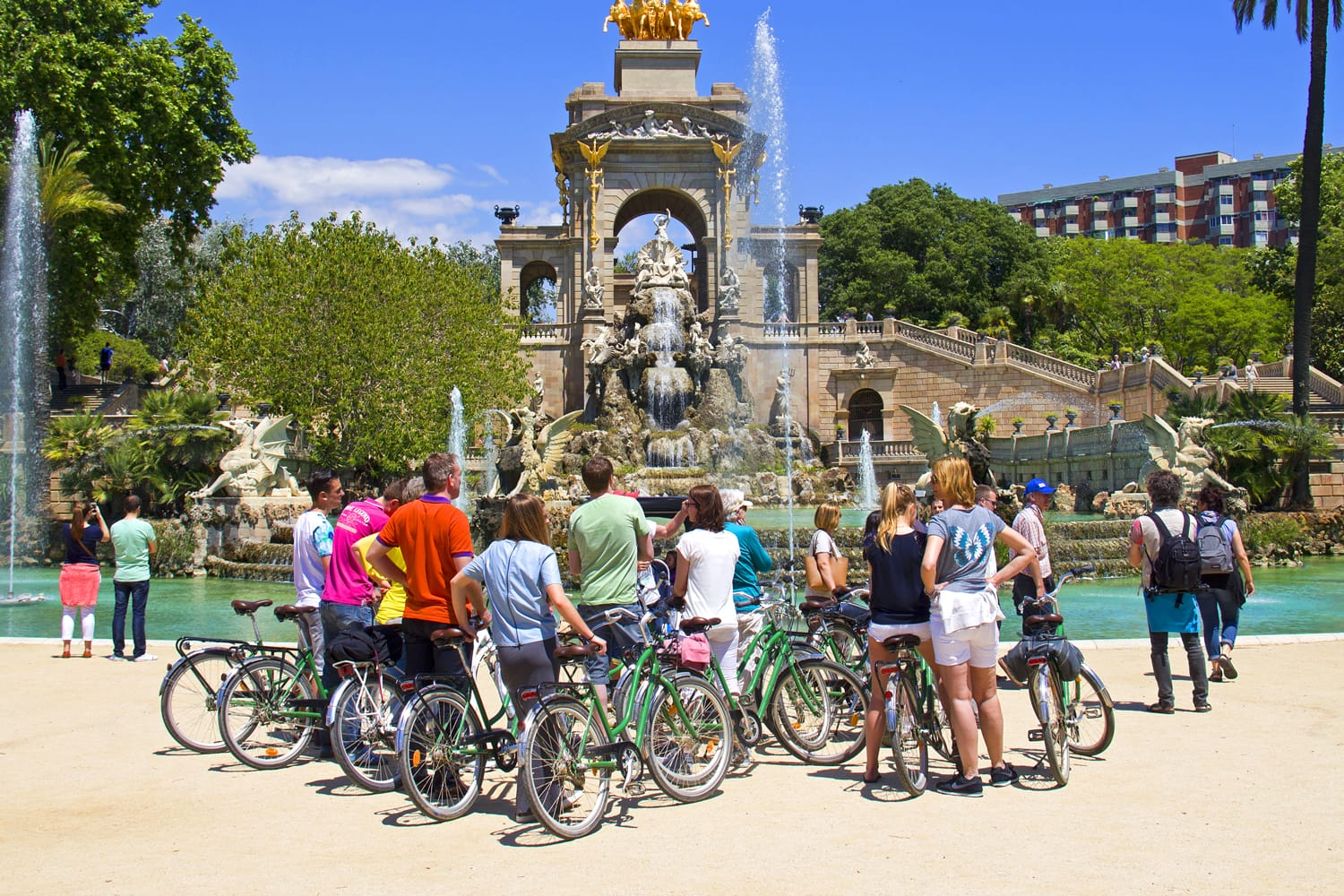 Tourist group on bicycles at the fountain in the Ciutadella Park in Barcelona, Spain