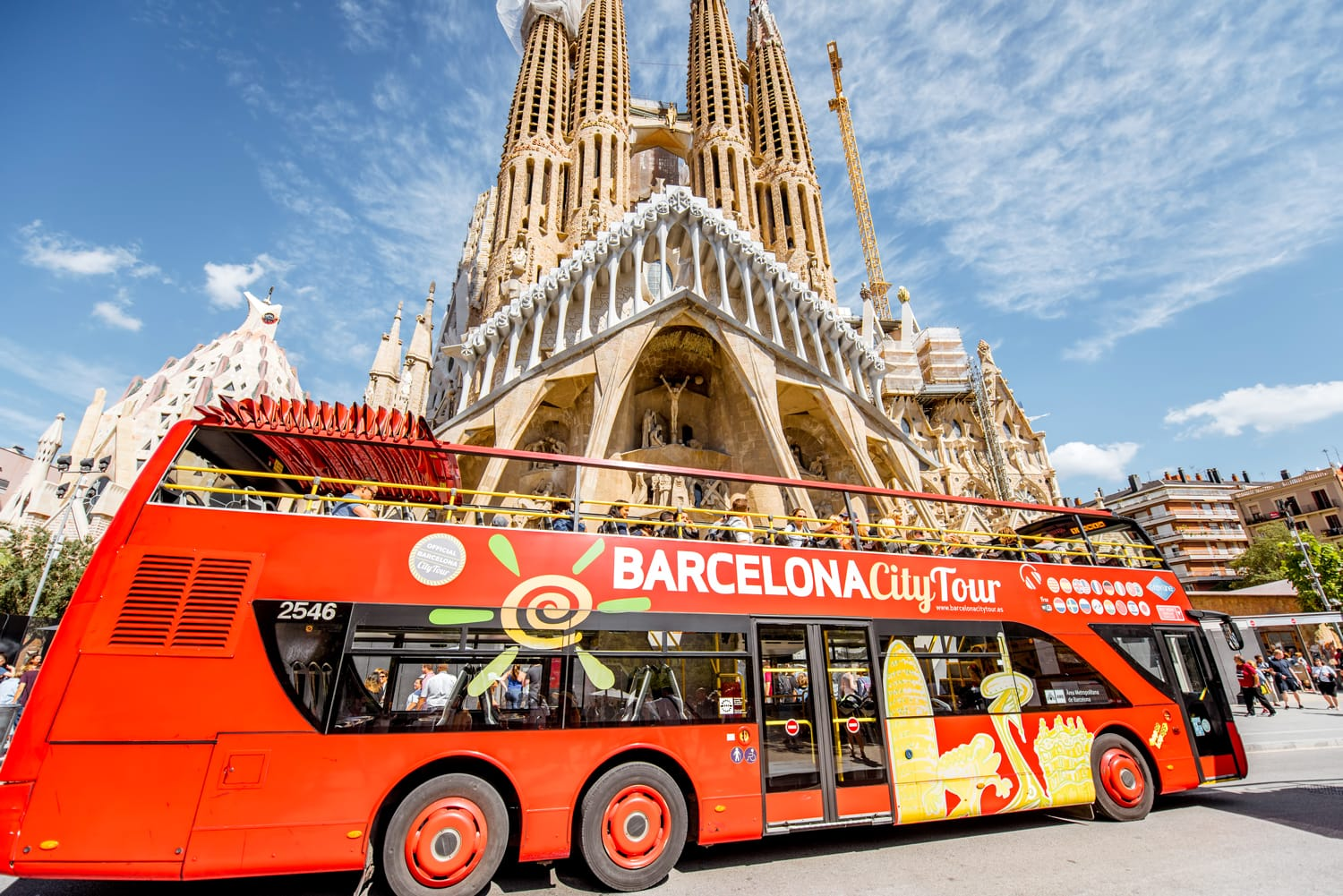 Tourist bus near the famous Sagrada Familia roman catholic church in Barcelona, designed by catalan architect Antoni Gaudi