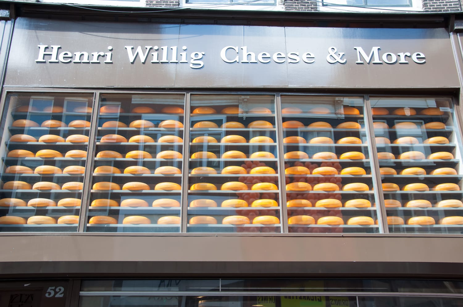 Various Dutch cheese displayed for sale in a local shop in Amsterdam.
