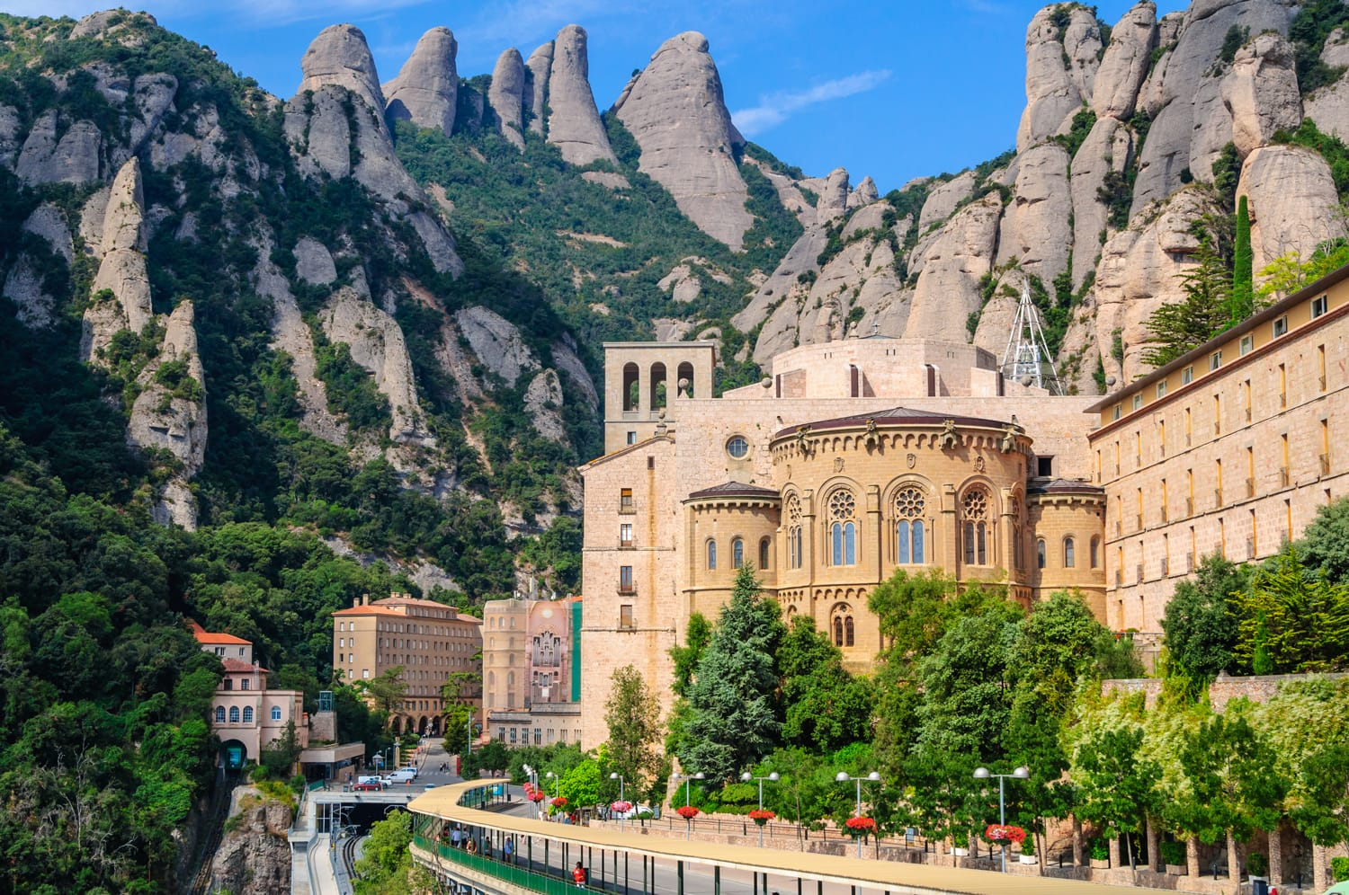 View the famous Catholic monastery of Montserrat on the background of round rocks. Catalonia, Spain.