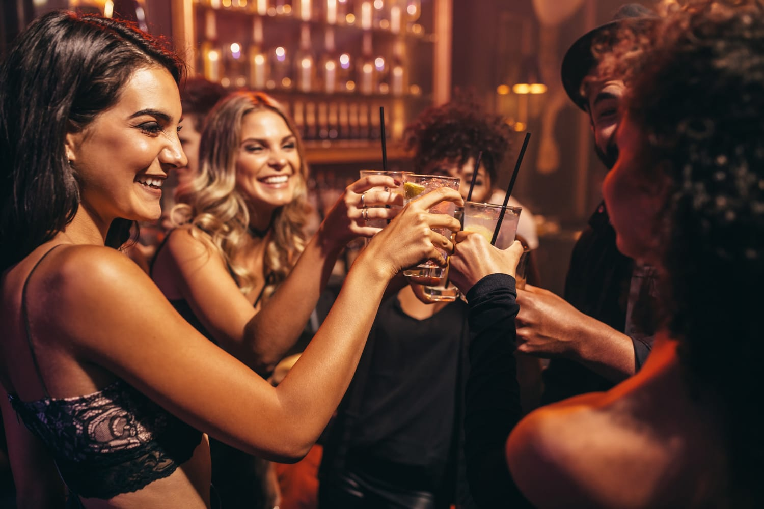 Group of young people with cocktails at nightclub