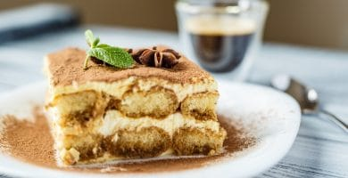 Delicious tiramisu on a wooden background
