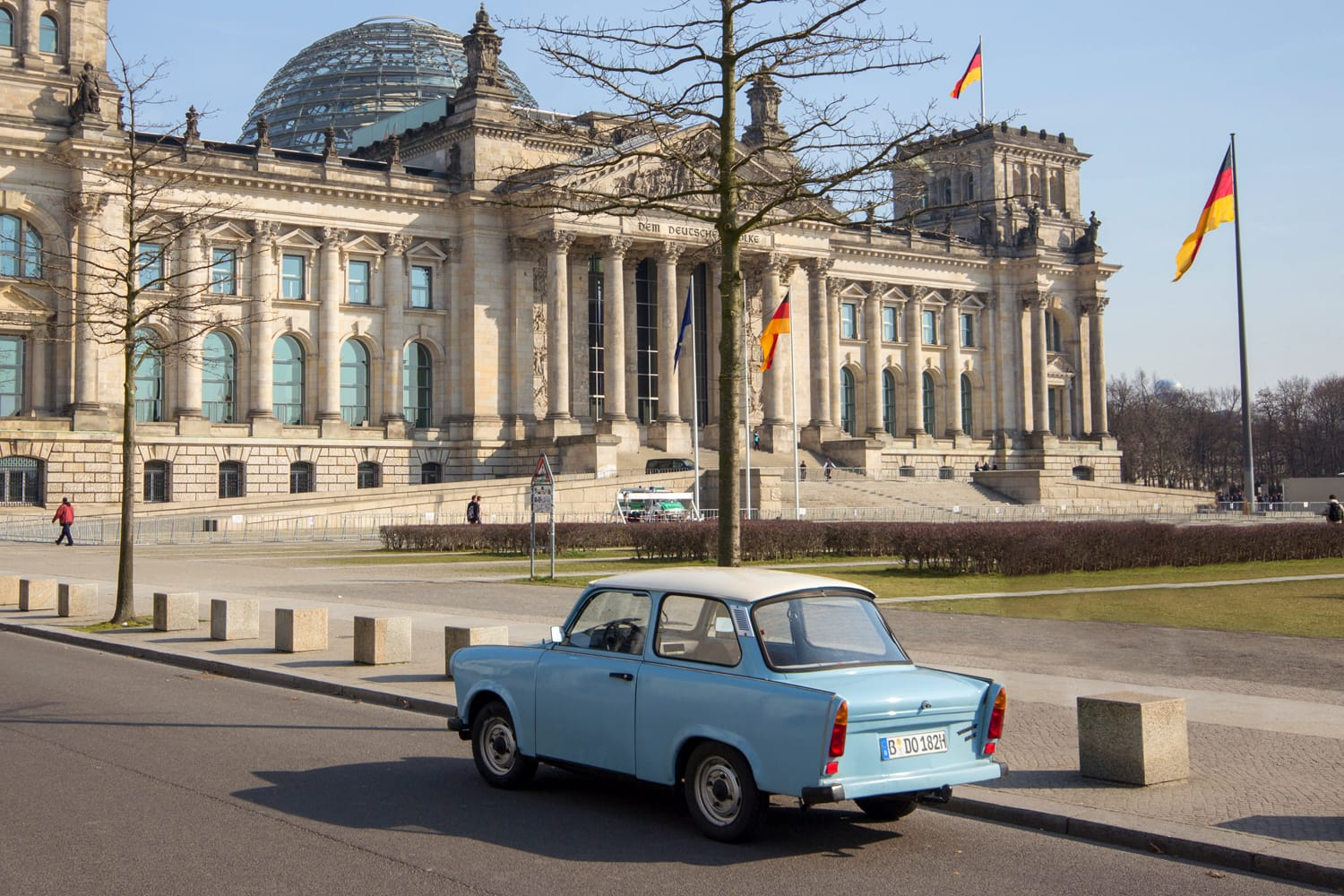 Trabi Car in front of the Reichstag Building in Berlin, Germany