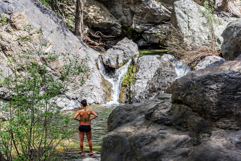 oung woman enjoying Salmon Creek Falls on a warm day