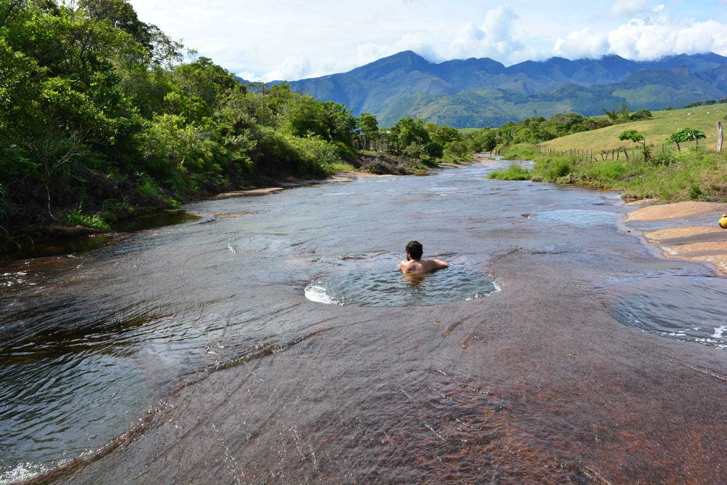 Unidentified man bathing in las gachas river, near to Guadalupe colonial town, in Colombia