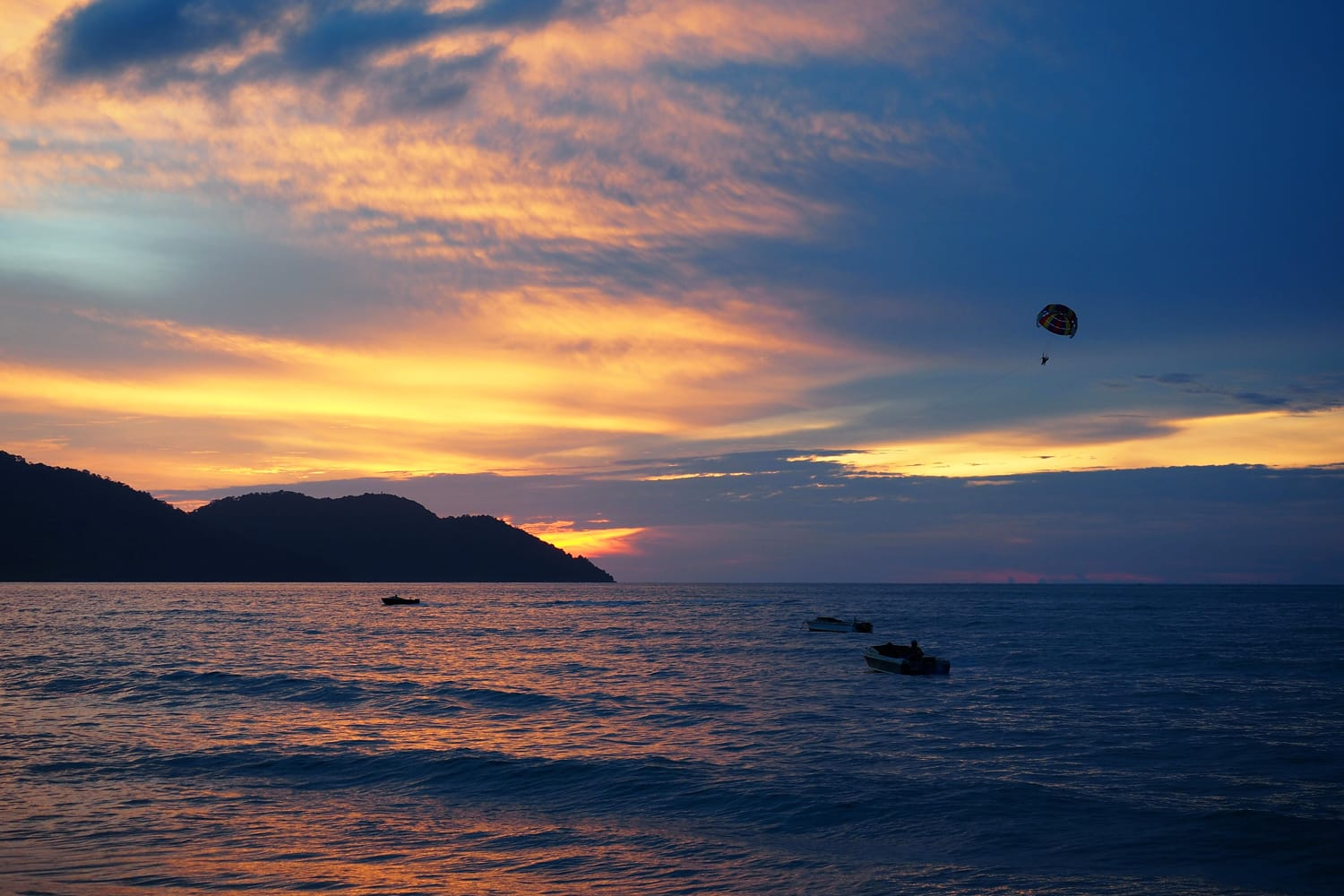 Parasailing with sunset background at Batu Ferringhi, Penang