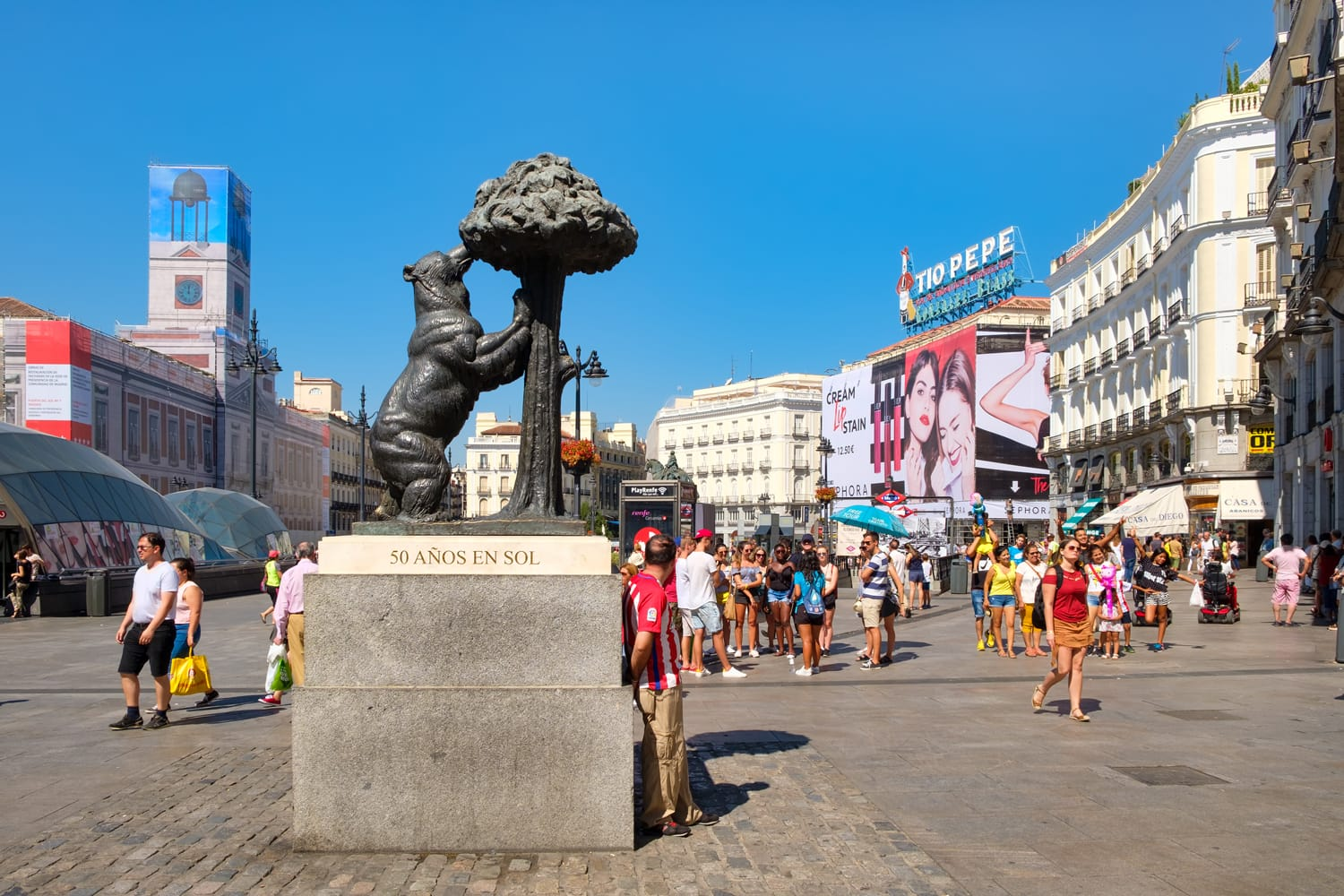 Puerta del Sol, one of the busiest places in Madrid with the statue of a bear and a madrone tree, the symbol of the city