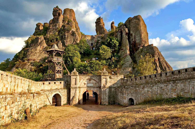 Belogradchik rocks Fortress in sunset cloudy sky, Bulgaria, Europe