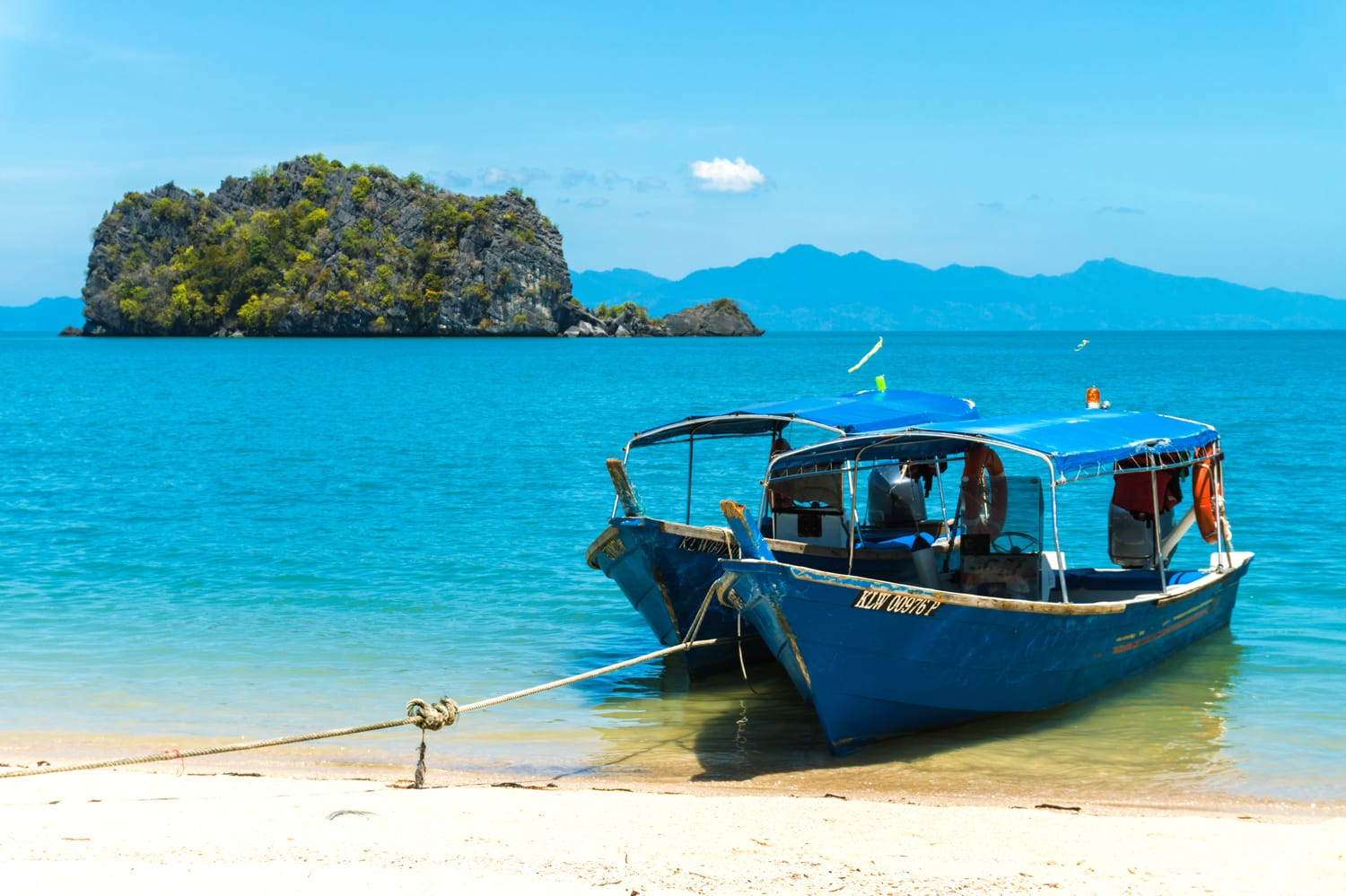 Boats for excursion on the beach on the island of Langkawi, Malaysia