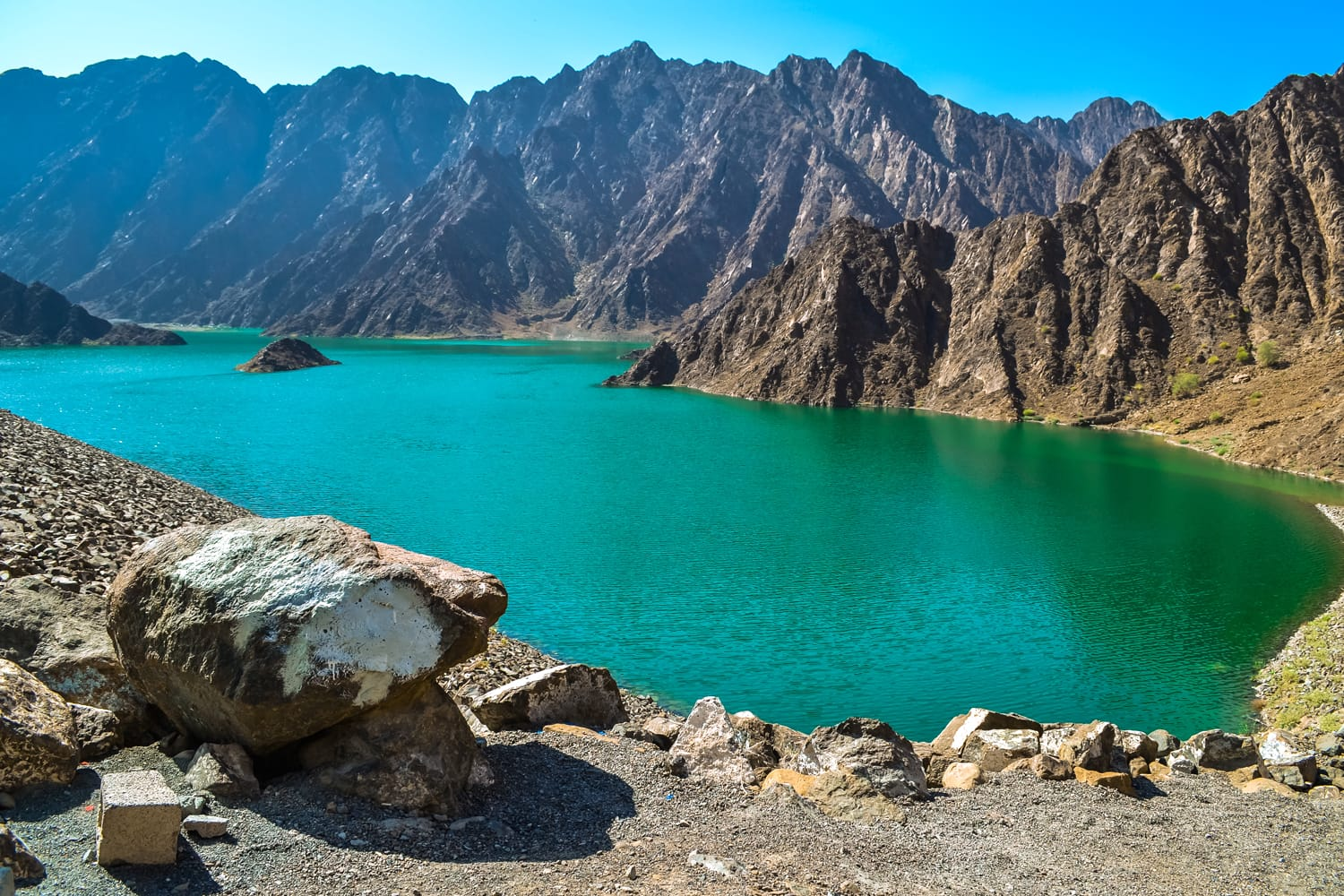 Hatta Dam Green Lake between mountains in Dubai, United Arab Emirates