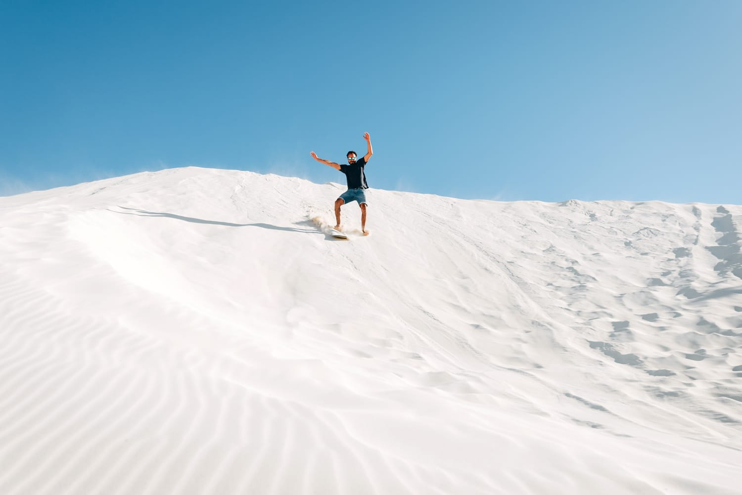 Sand boarding at the Lancelin sand dunes near Perth, Western Australia