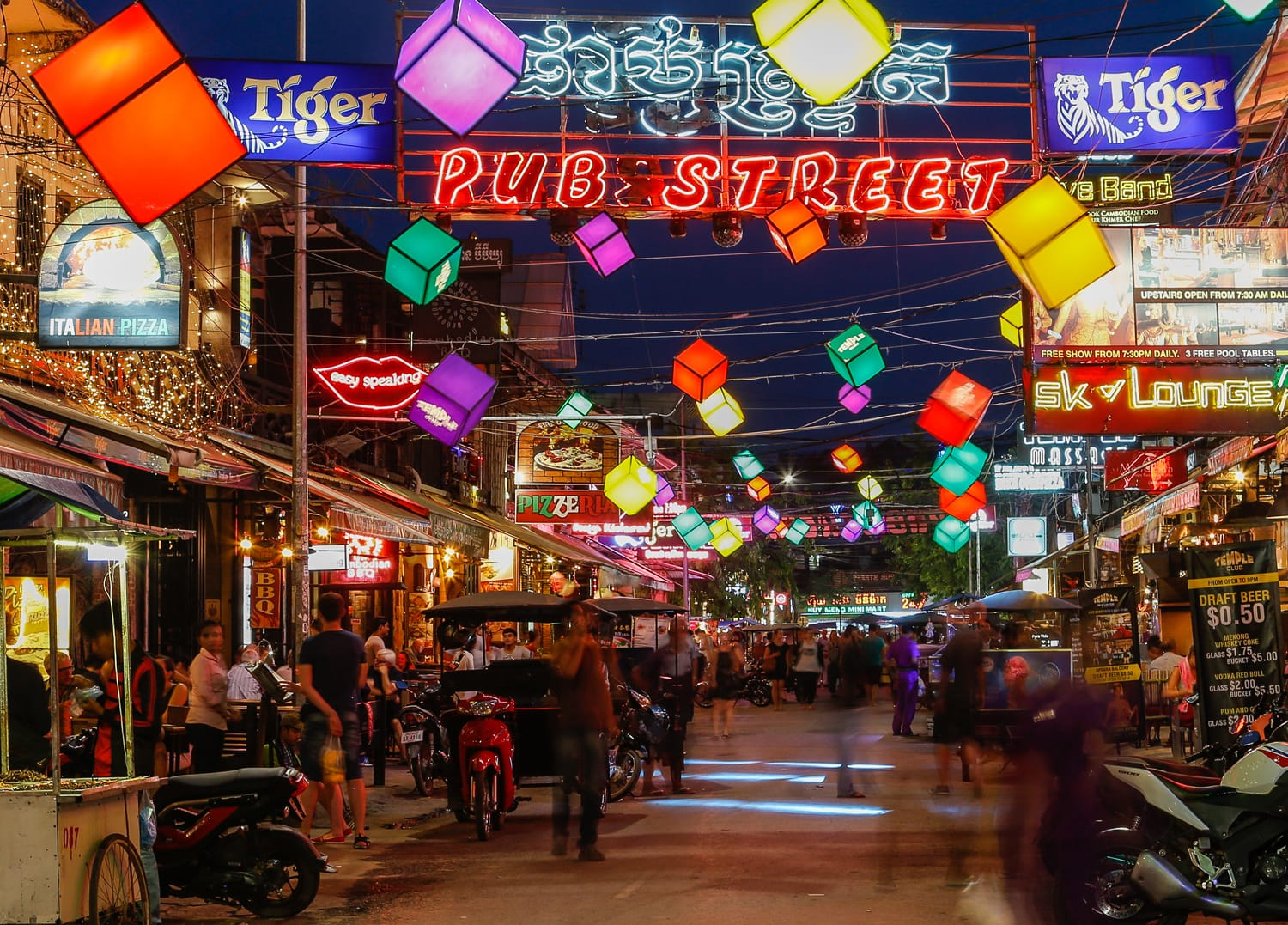 Bars, restaurants and lights along Pub Street in Siem Reap Cambodia at night