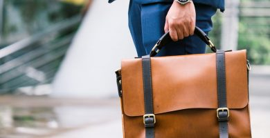 businessman holding leather briefcase
