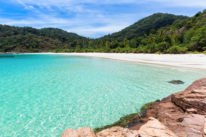 Deserted Malaysian tropical beach on Pulau Redang Island, Malaysia