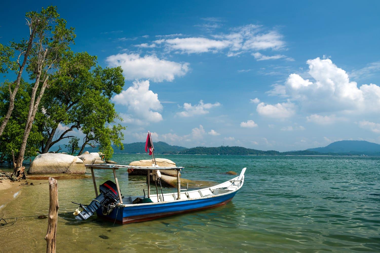 Fishing boat at the beach in Sungai Pinang Kecil, Pangkor Island, Perak, Malaysia
