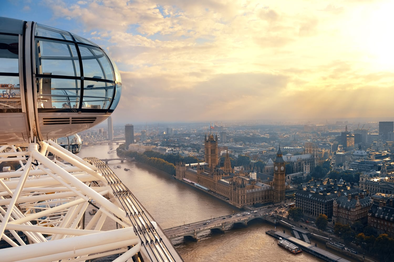 London Eye over Thames River in London, UK.