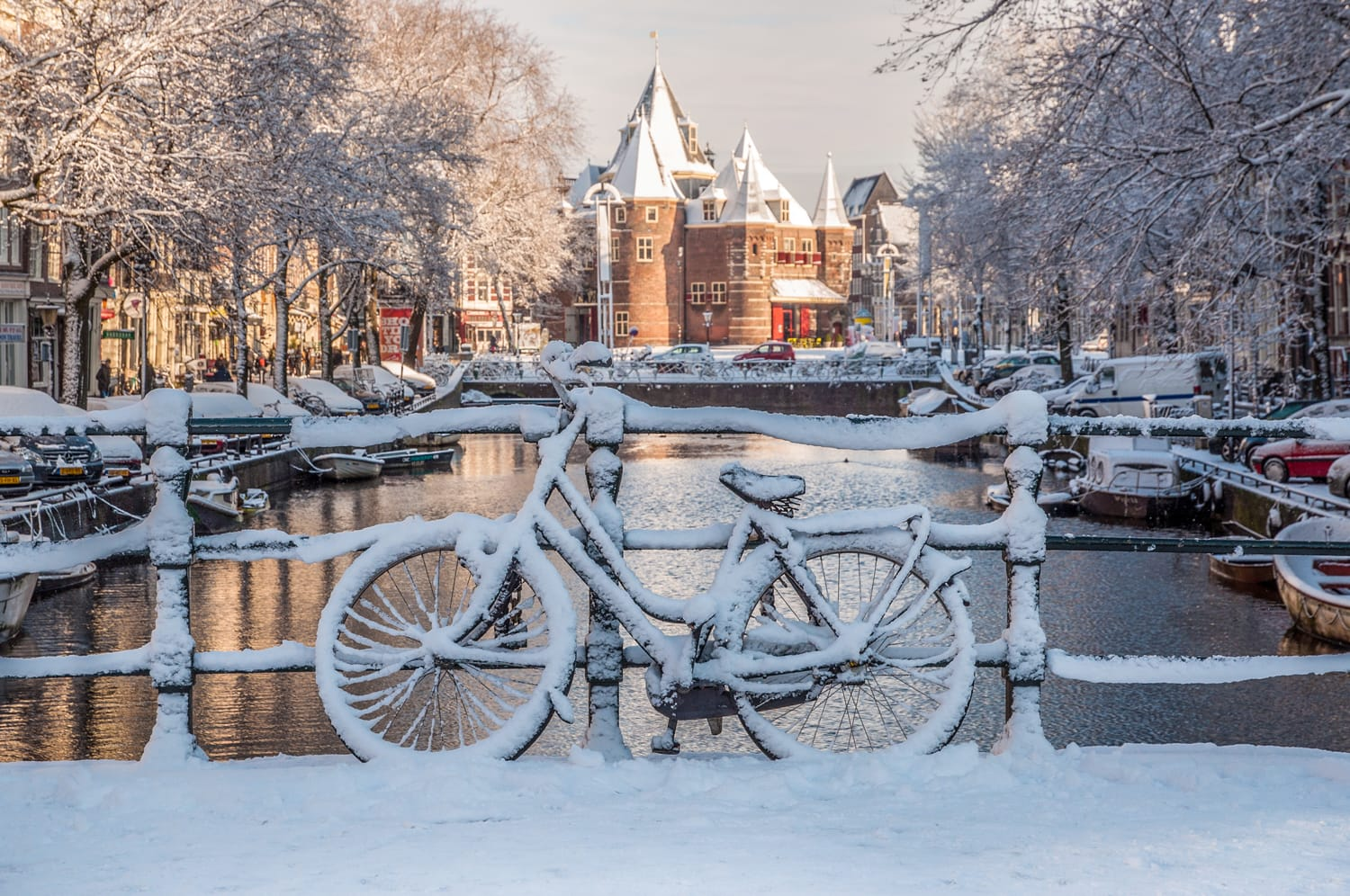 Bicycles under the Snow, view on Nieuwmarkt, Amsterdam Channels