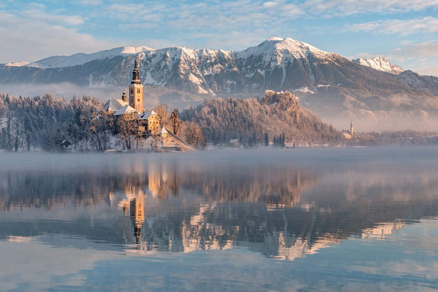 Lake Bled with the church and the castle on a calm winter morning