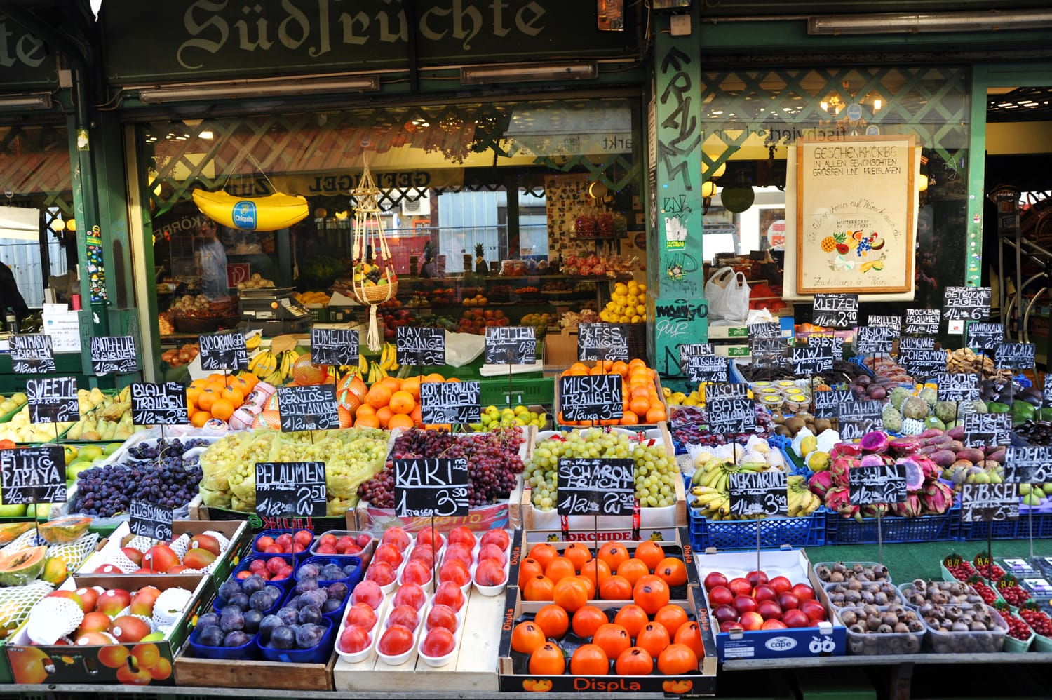 Fruit stand with fresh fruits at a market Naschmarkt during Christmas period in Vienna, Austria
