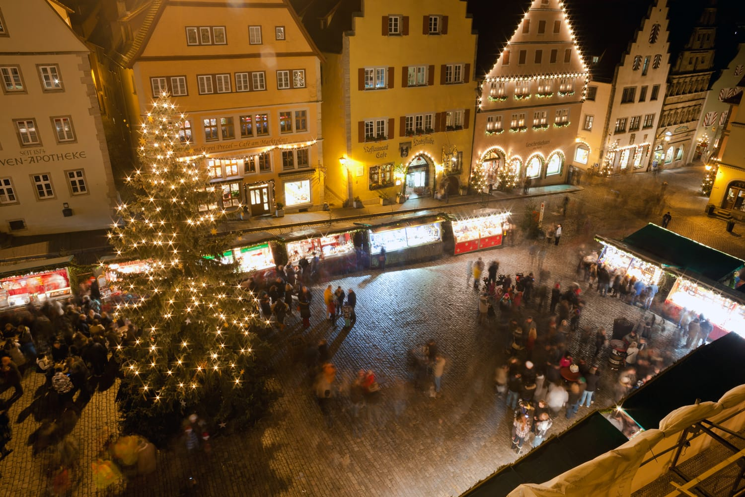 Christmas Markets in central square by night in Rothenburg ob der Tauber, Germany