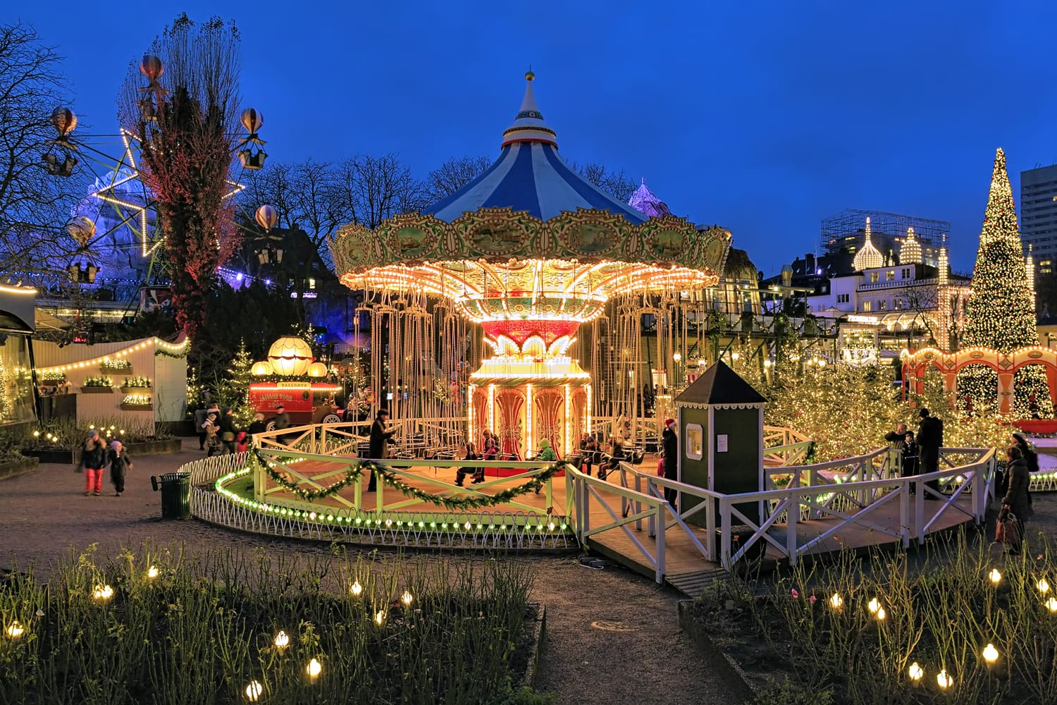 The carousel and christmas illumination in Tivoli Gardens, a famous amusement park and pleasure garden in Copenhagen, Denmark