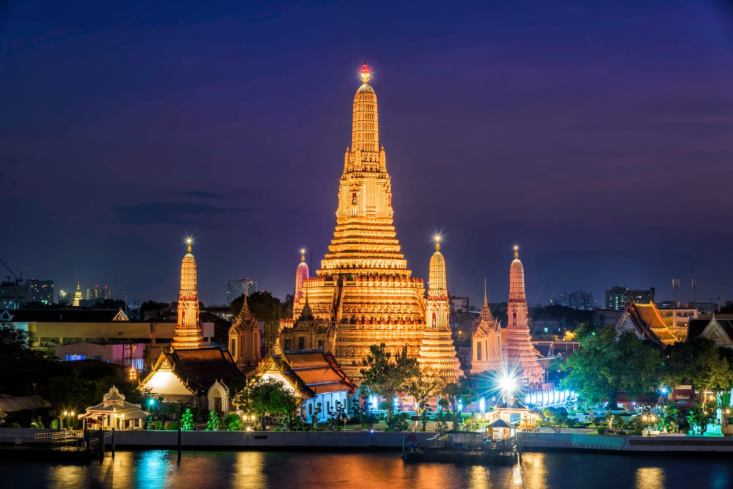 Wat Arun Temple at twilight in Bangkok Thailand .