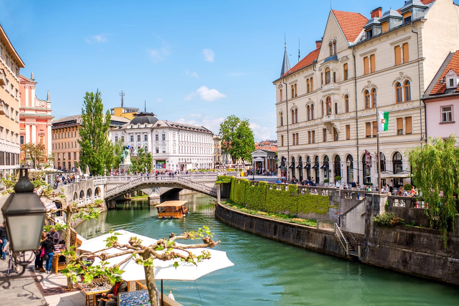 Cityscape view on Ljubljanica river canal in Ljubljana old town. Ljubljana is the capital of Slovenia and famous european tourist destination.
