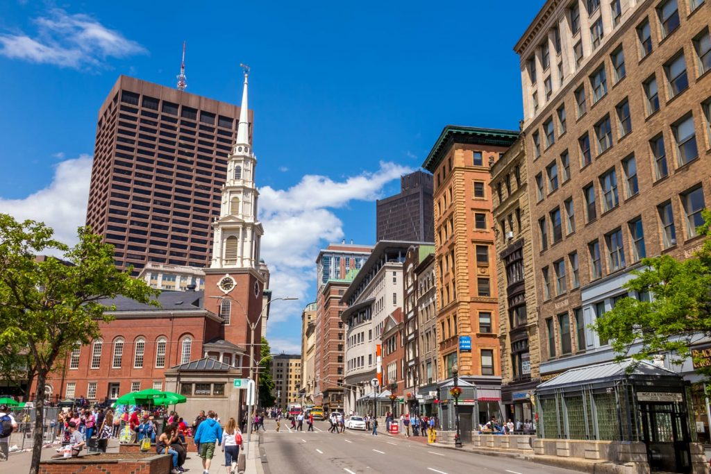 Boston's Freedom trail with the Park Street Church in the background on May 30, 2014. The Freedom Trail is a 2.5-mile-long red (mostly brick) path through downtown Boston.