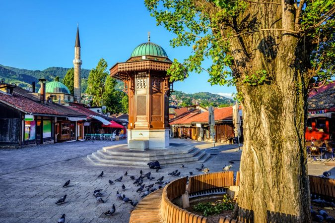 Bascarsija square with Sebilj wooden fountain in Old Town Sarajevo, capital city of Bosnia and Herzegovina