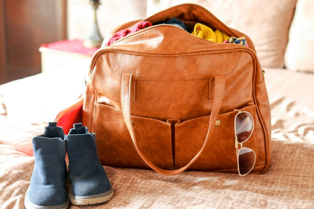 weekender bag on bed