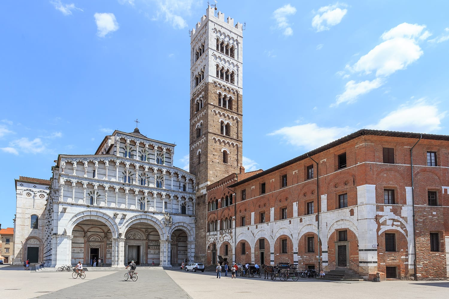 Romanesque Facade and bell tower of St. Martin Cathedral in Lucca, Tuscany. It contains most precious relic in Lucca, Holy Face of Lucca (Italian: Volto Santo di Lucca)