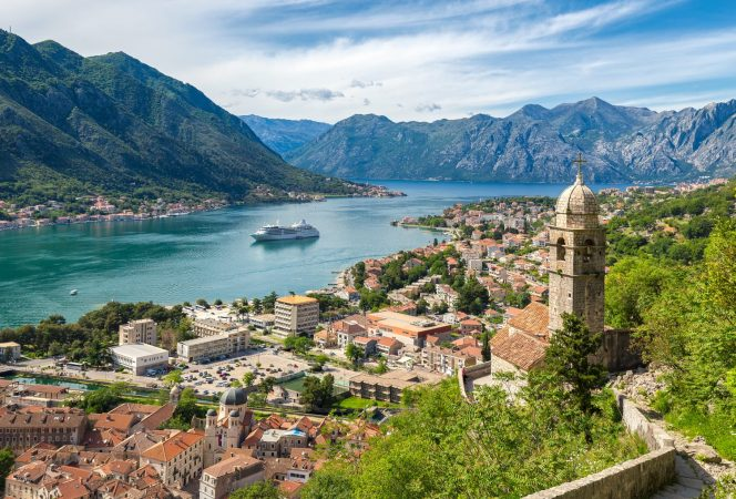 Classic panorama view of the historic Church of Our Lady of Remedy overlooking the old town of Kotor and world-famous Bay of Kotor, Montenegro