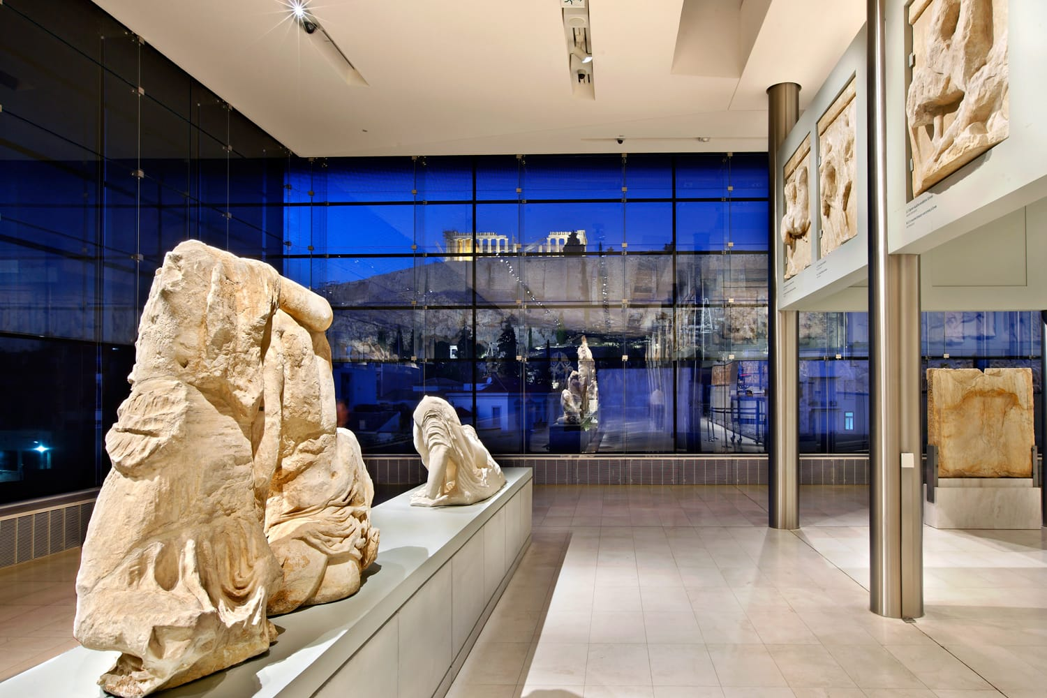 Inside view of the (new) Acropolis museum (part of the Parthenon gallery on the 3rd floor). In the background, through the glass you can see the Acropolis. Athens, Greece