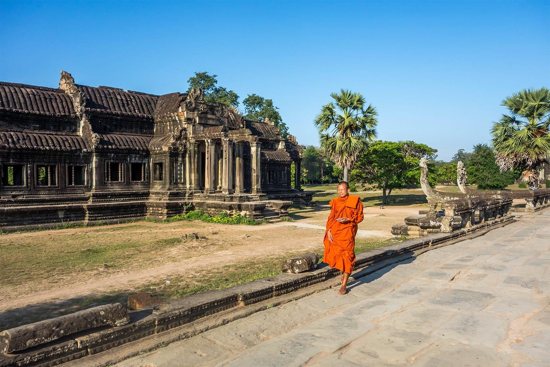 Monk walking at Angkor Wat in Cambodia