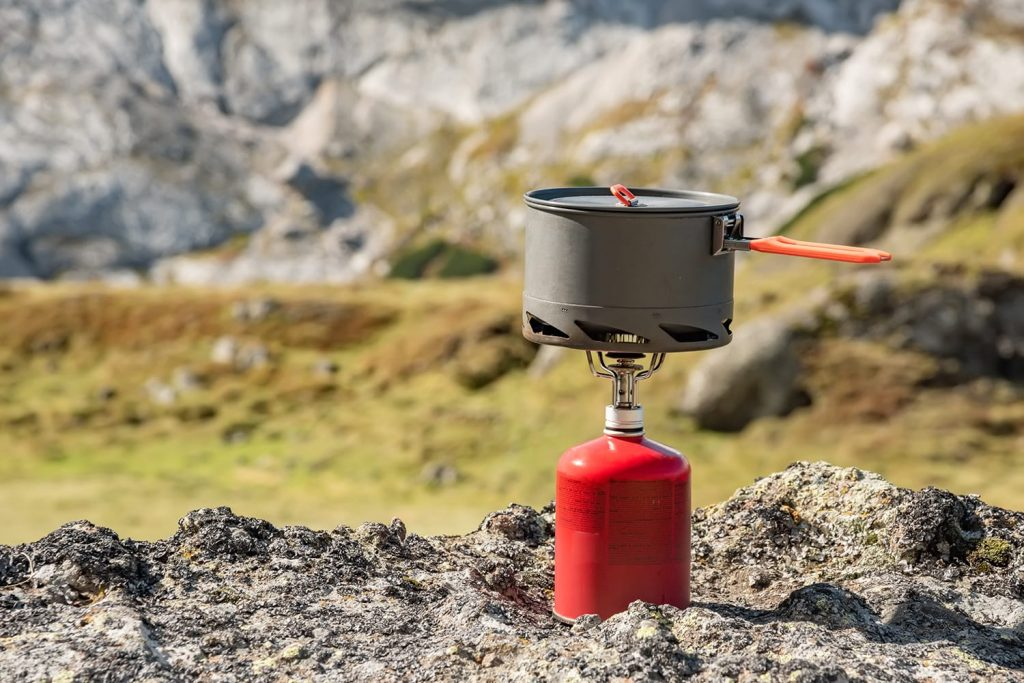 Backpacking stove with mountain background