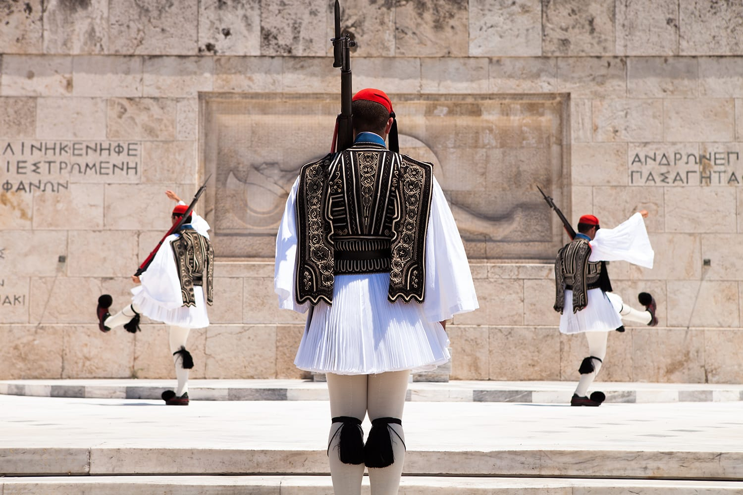 The Changing of the Guard ceremony takes place in front of the Greek Parliament Building in Athens, Greece.